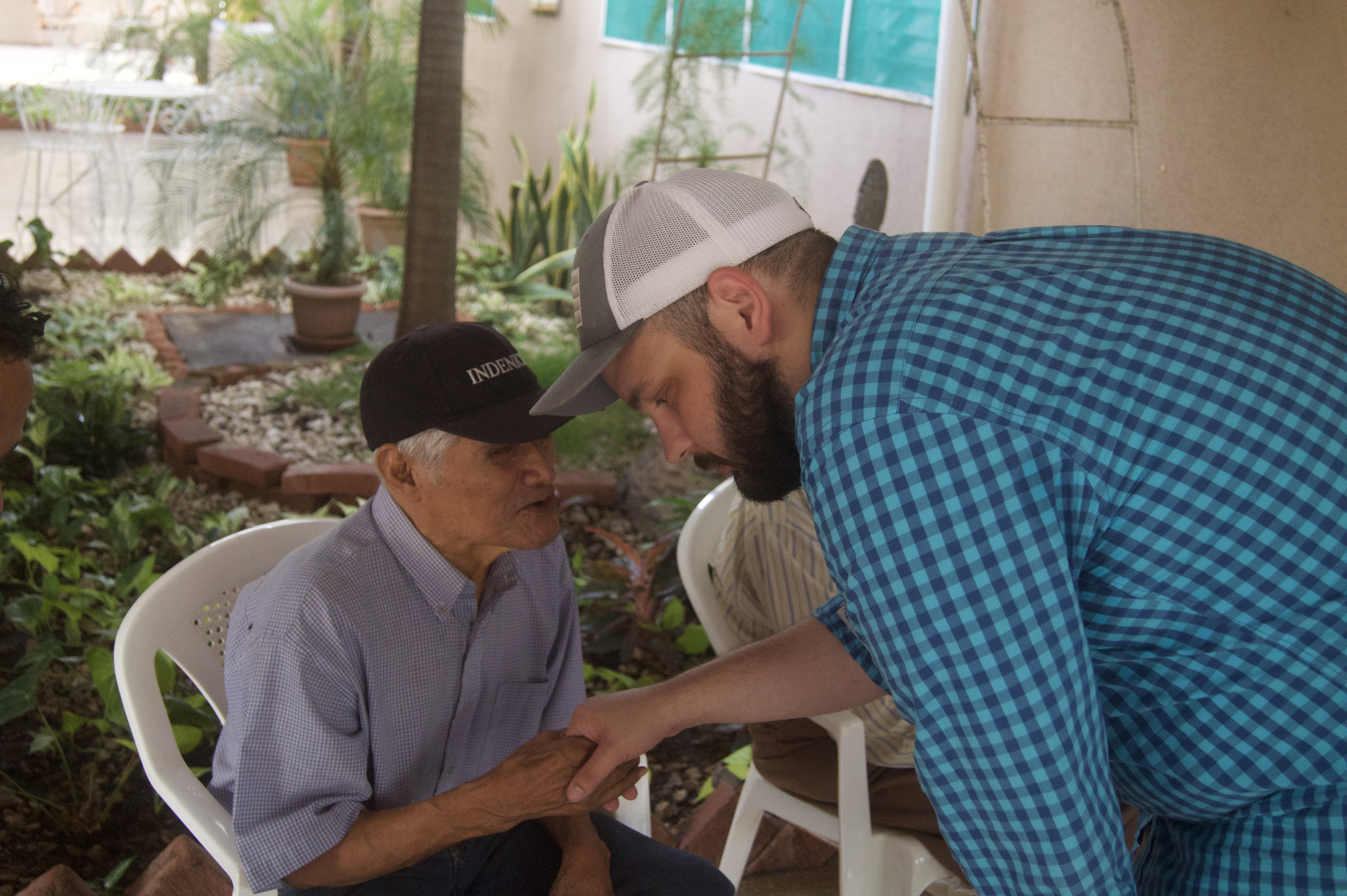 Pastor Rieger talks with a resident