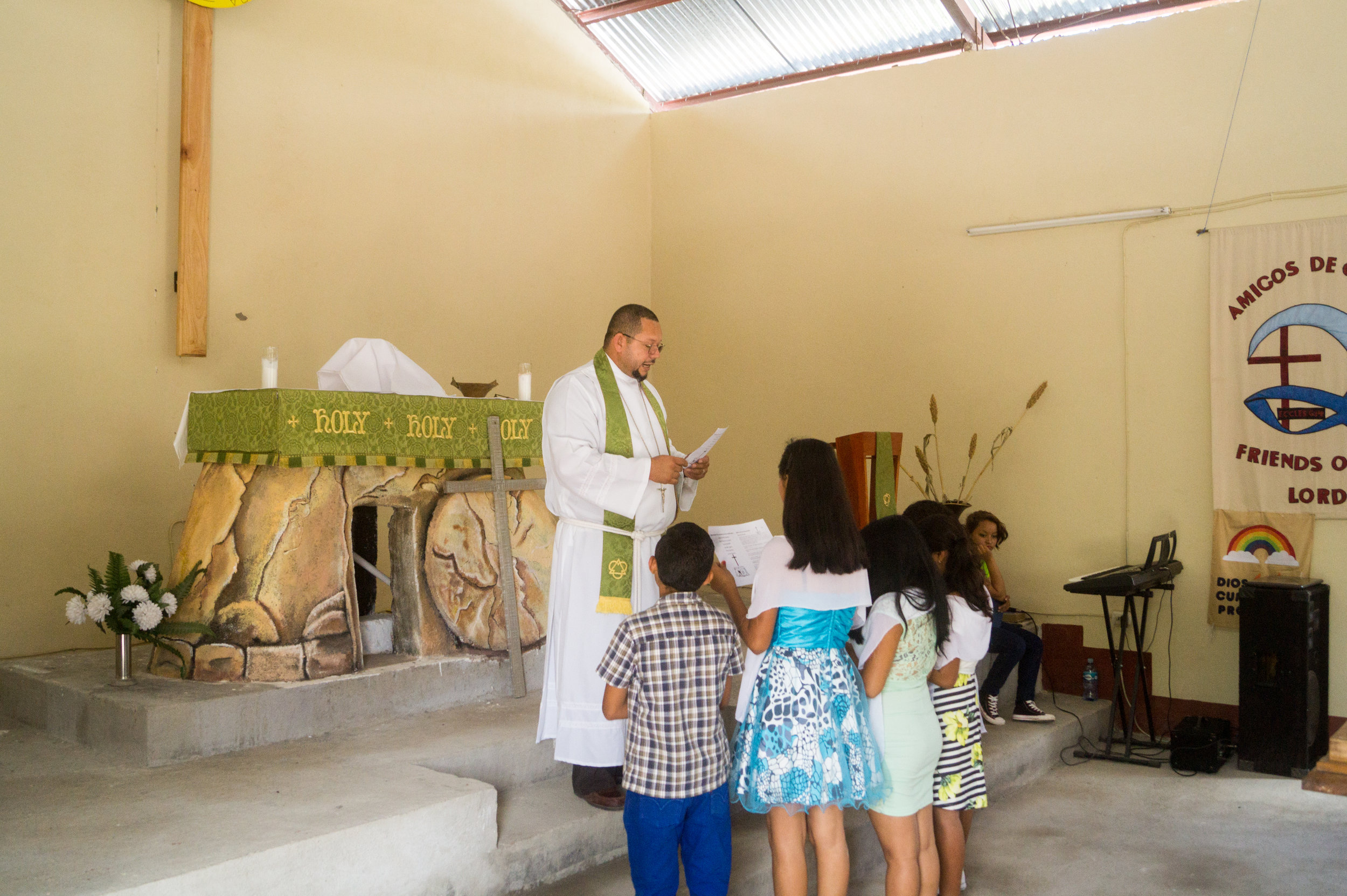 Pastor Hector confirming the young people