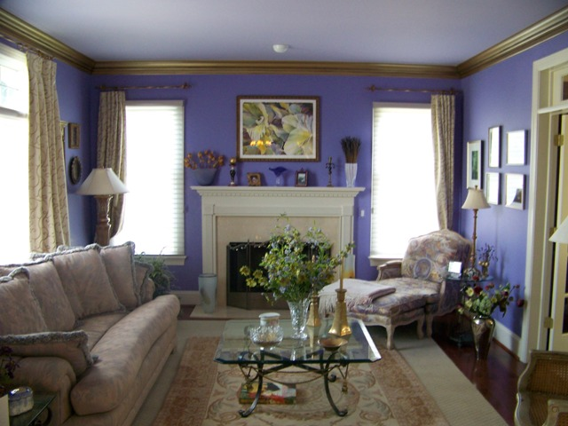 Purple painted living room with metallic gold trim