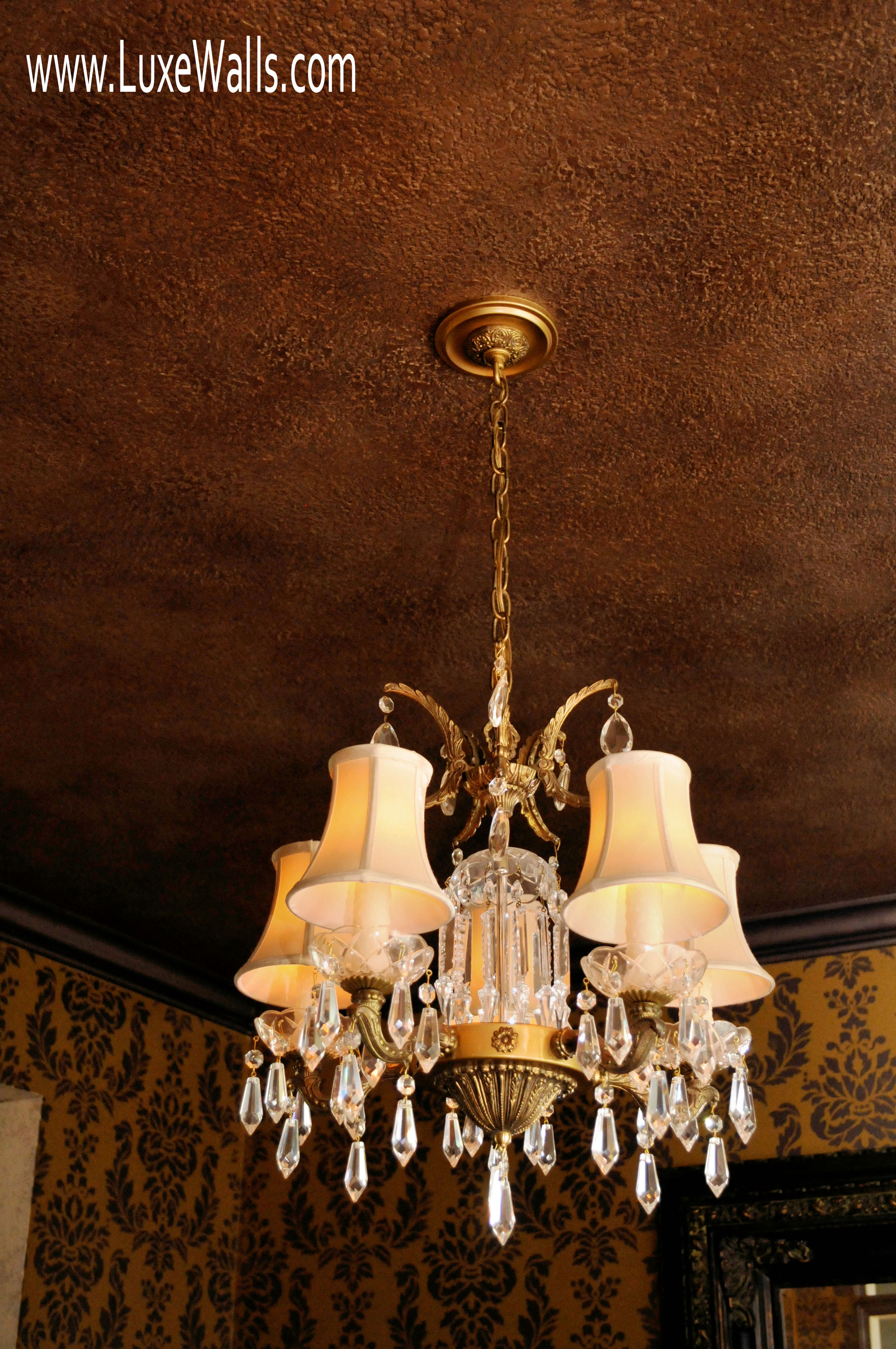 This light fixture, from the homeowner's childhood home, served as the inspiration for the color pallet.