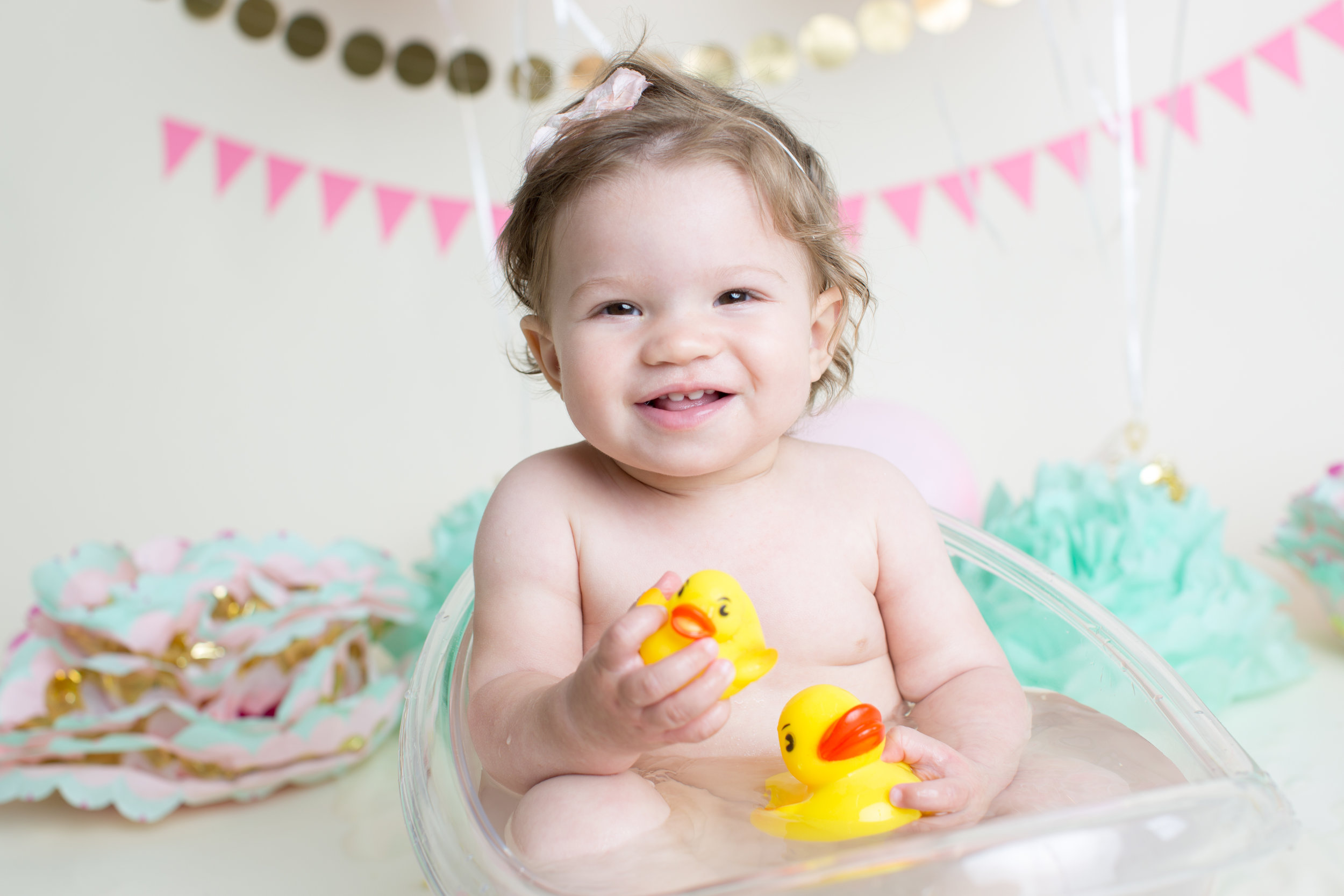 Boutique Bath Sessions  $175  Bath sessions are extra fun! You can choose from bubble baths complete with rubber duckies or a milk bath with a special garnish of your choice. This is great for ages 3 and under. I'll fill a large tub with warm water and powered milk and then a garnish of your choice. We've done cookies, flowers, and cereal just to name a few. These sessions last 20 minutes and galleries typically have 15-20 photos.