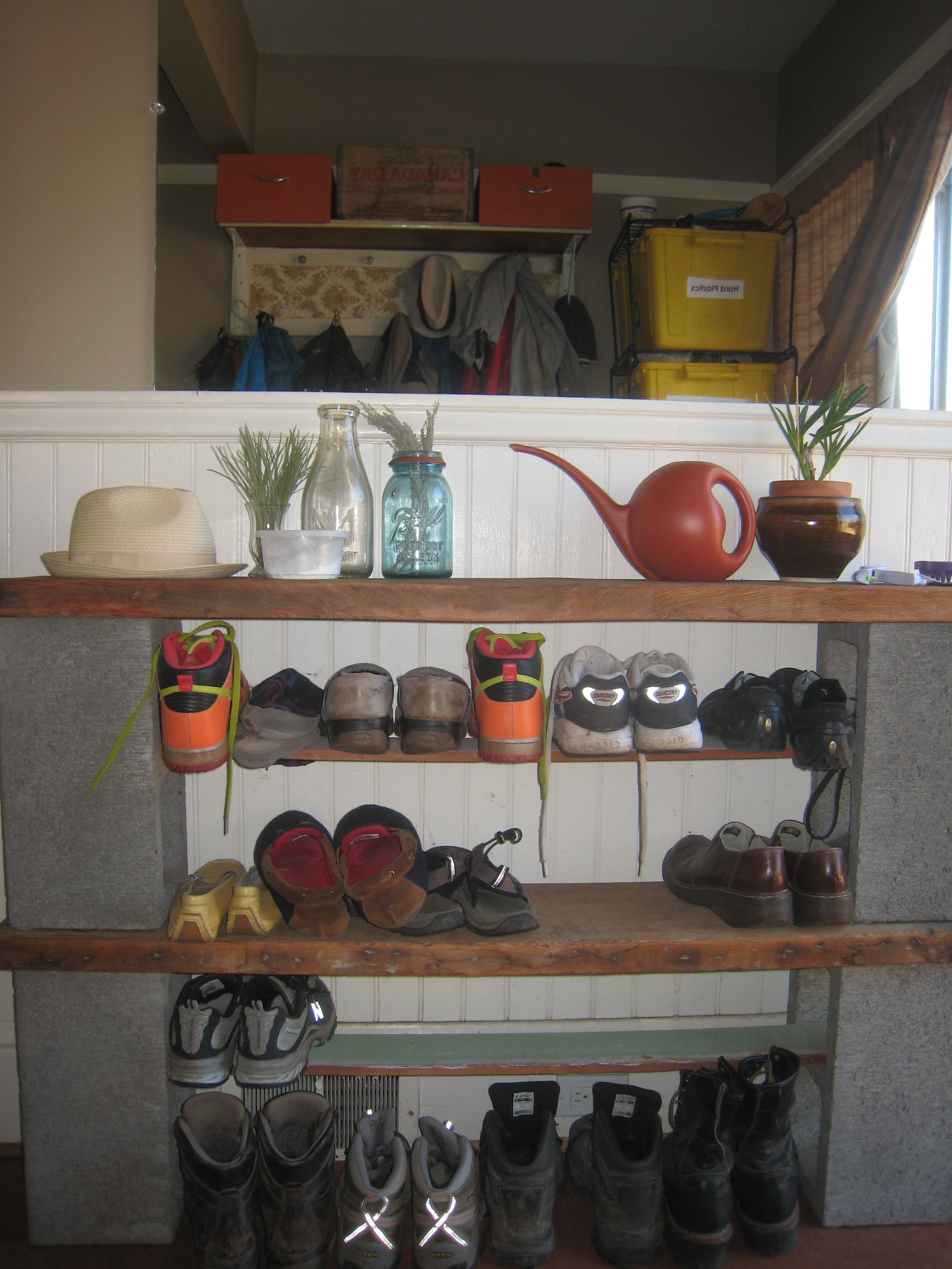 BEFORE: Dark and heavy shoe shelf with everything visible (cinder blocks, just...no.)