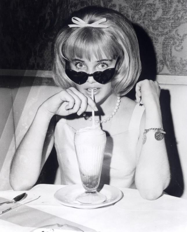 sue lyon with drink and sunglasses.jpg