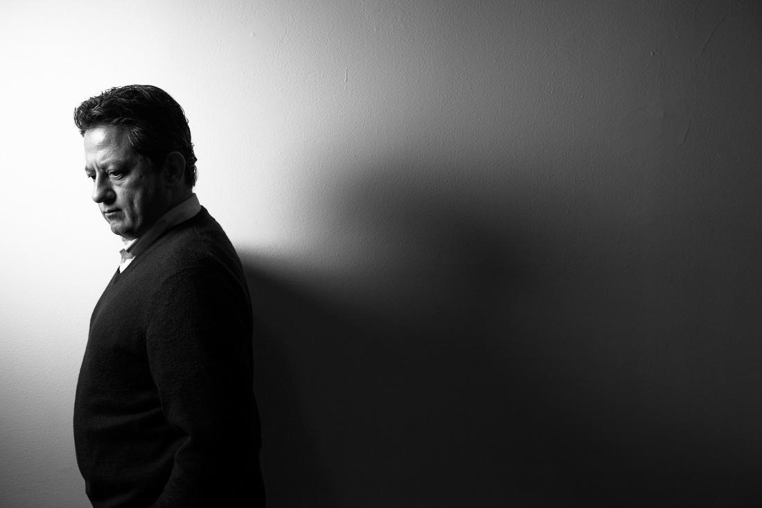 thought leader Higher Brain Living Facilitator Dr. Steve Giron reflective B&W portrait