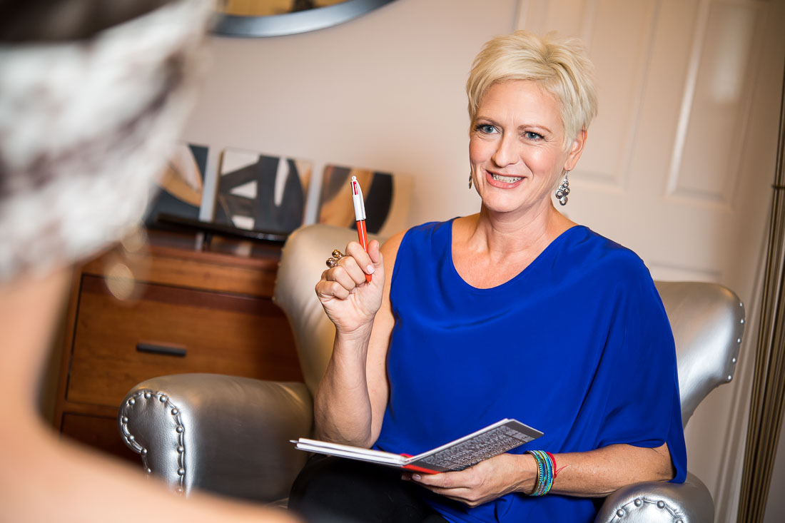 business headshot NYC - Carolyn Herfurth pen in hand