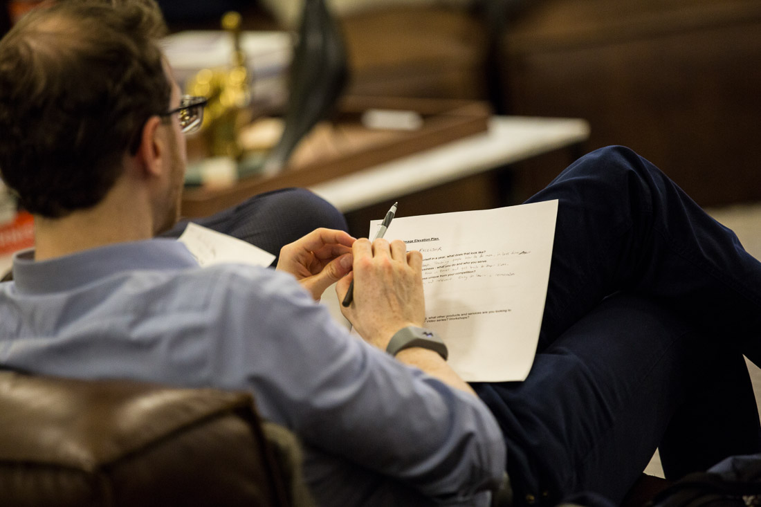 John DeMato Productions speaking fireside chat WeWork attendee taking notes