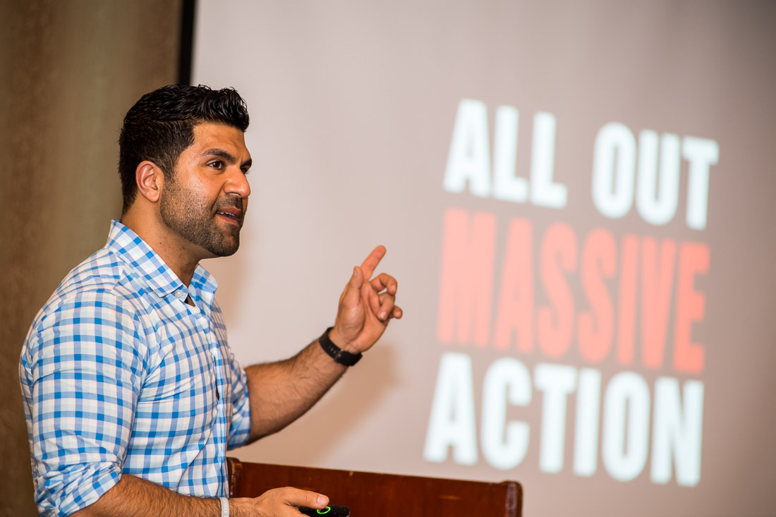 Coach AJ Mihrzad branded lifestyle portrait speaking from stage