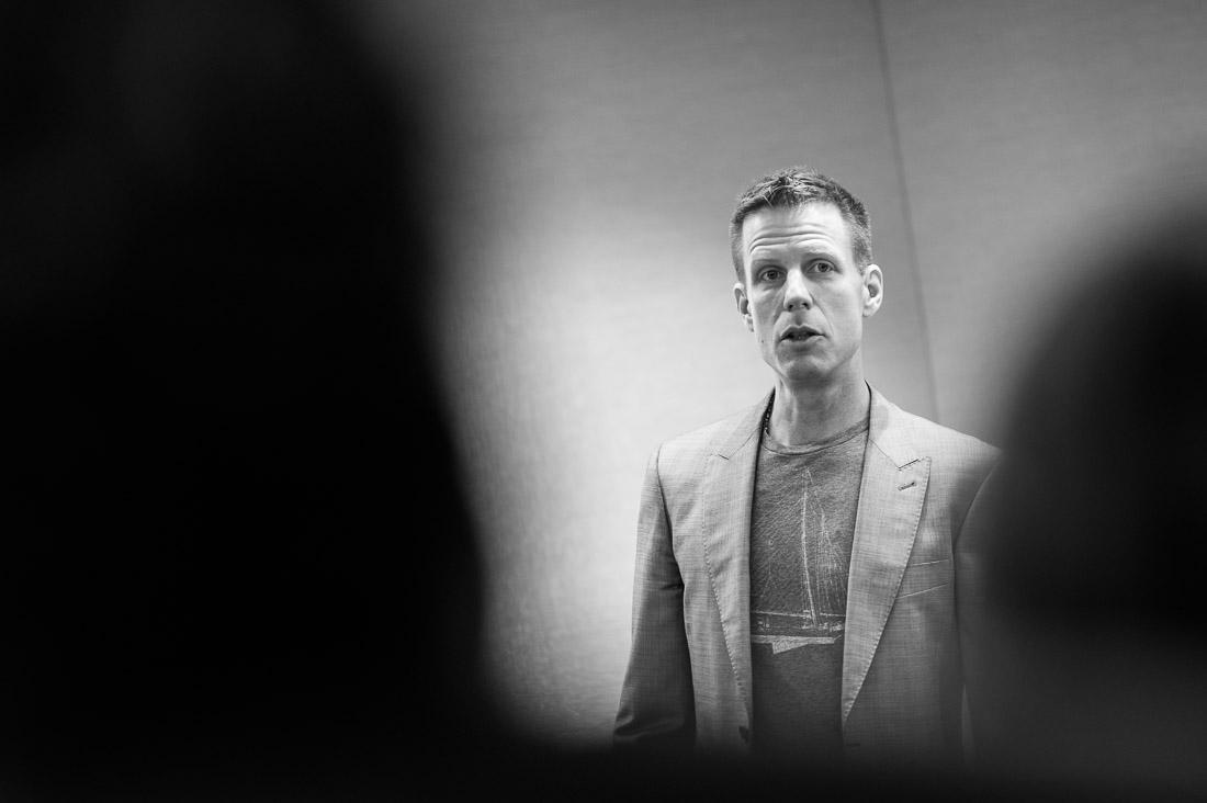 branded lifestyle portrait NYC Josh Spodek speaking from stage