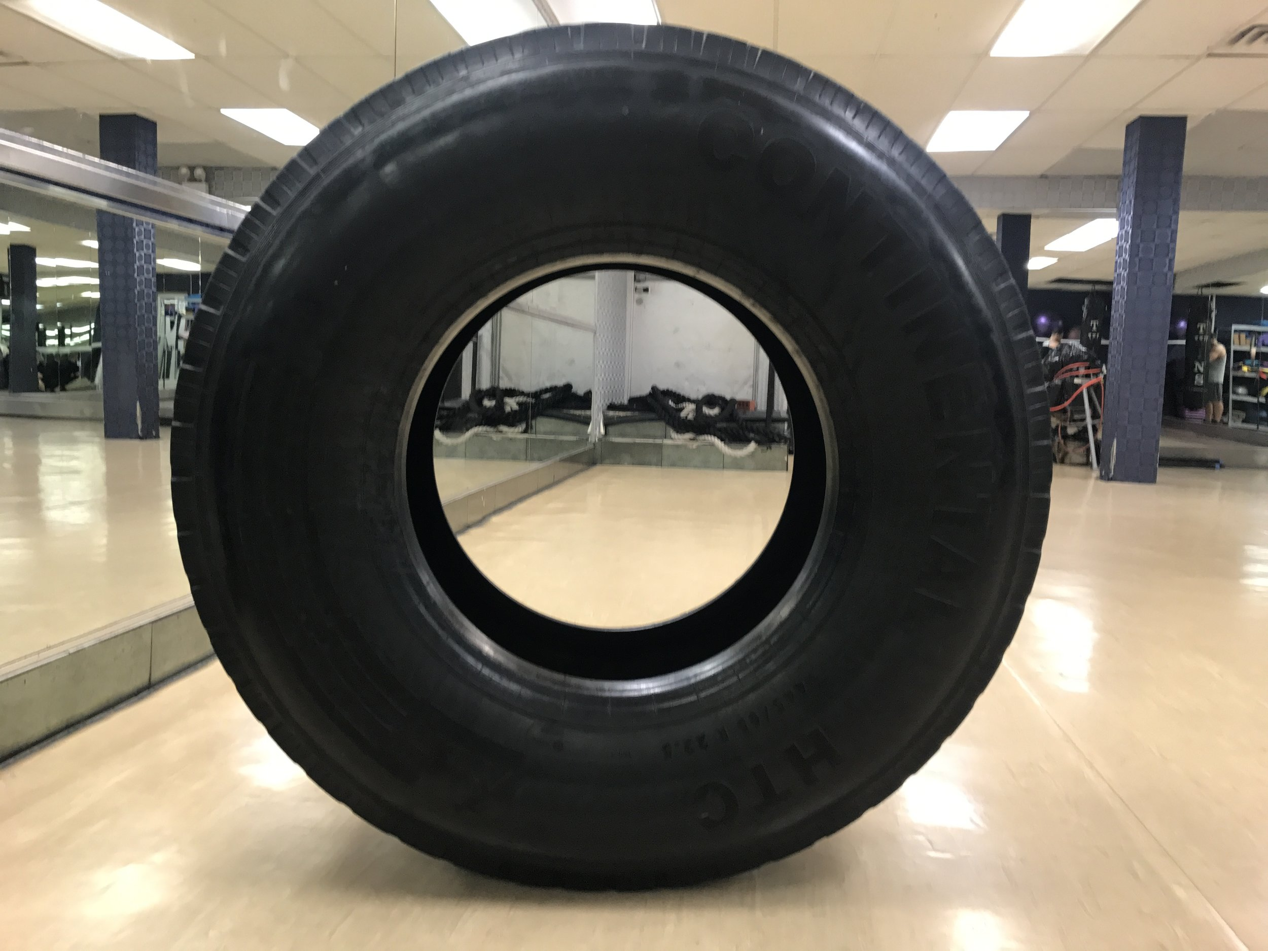 NYC branded lifestyle portrait tire at gym