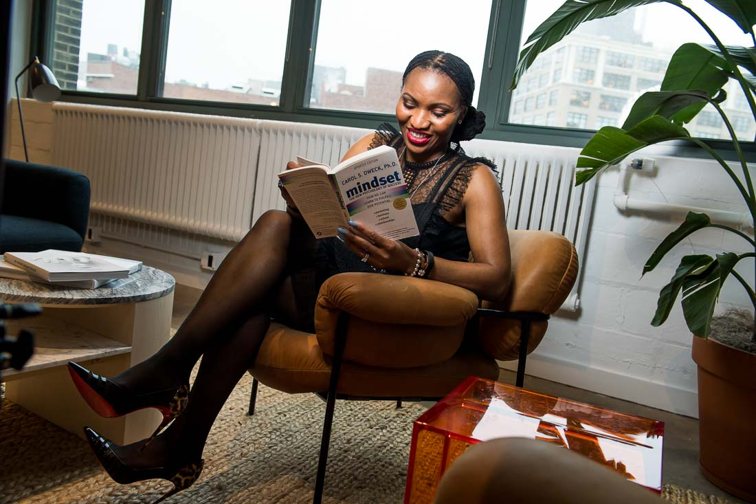 NYC Branded Lifestyle Portrait Chinwe Esimai reading a book