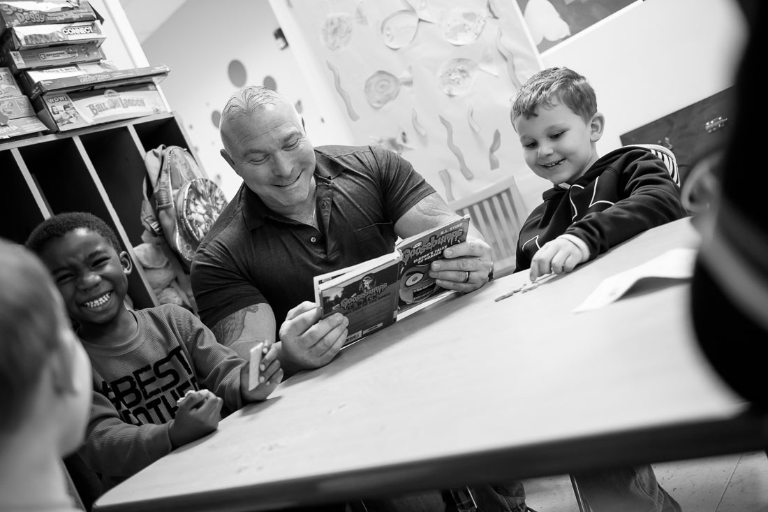 NYC Branded Lifestyle Portrait Angelwatch Dave Vitalli reading a book to kids