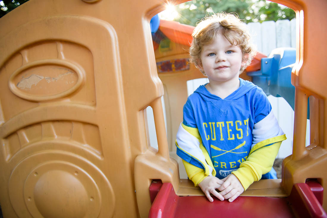 NYC Branded Lifestyle Portrait daycare center kid portrait on slide