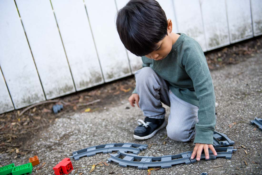 NYC Branded Lifestyle Portrait daycare center kid portrait with train tracks