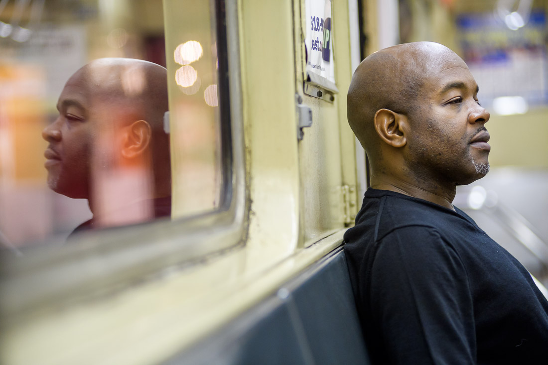 NYC Branded Lifestyle Portrait Podcaster G Moody MTA train reflection in window