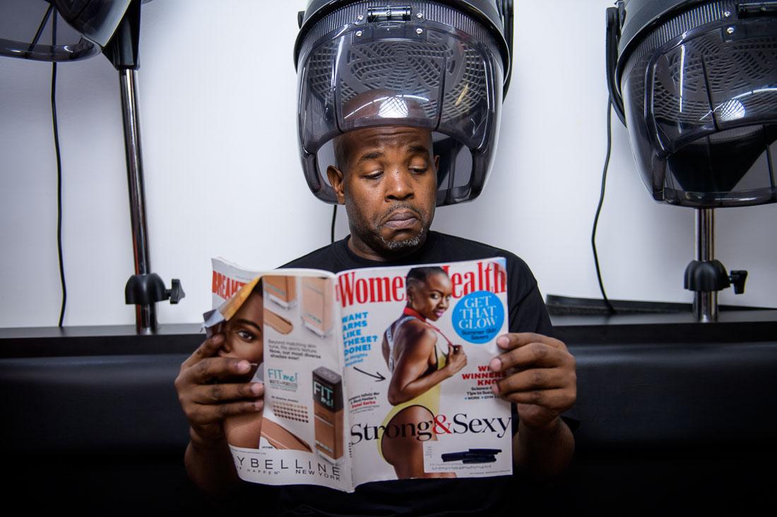 NYC Branded Lifestyle Portrait Podcaster G Moody hair dryer reading magazine