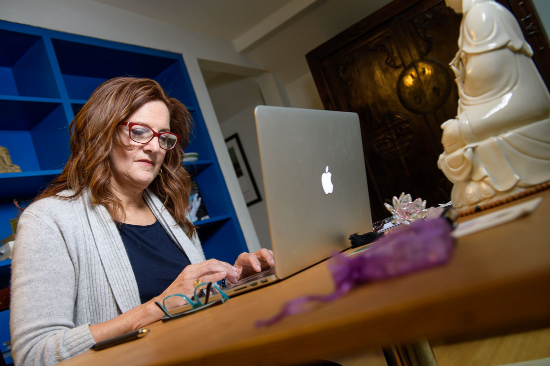 NYC Branded Lifestyle Portrait Speaker Coach Kate Mackinnon working on laptop