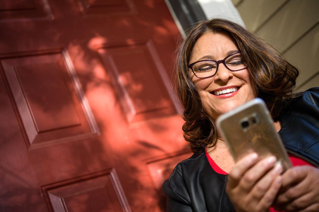 Branded Lifestyle Portrait of Social Media Expert Donna Cravotta on phone
