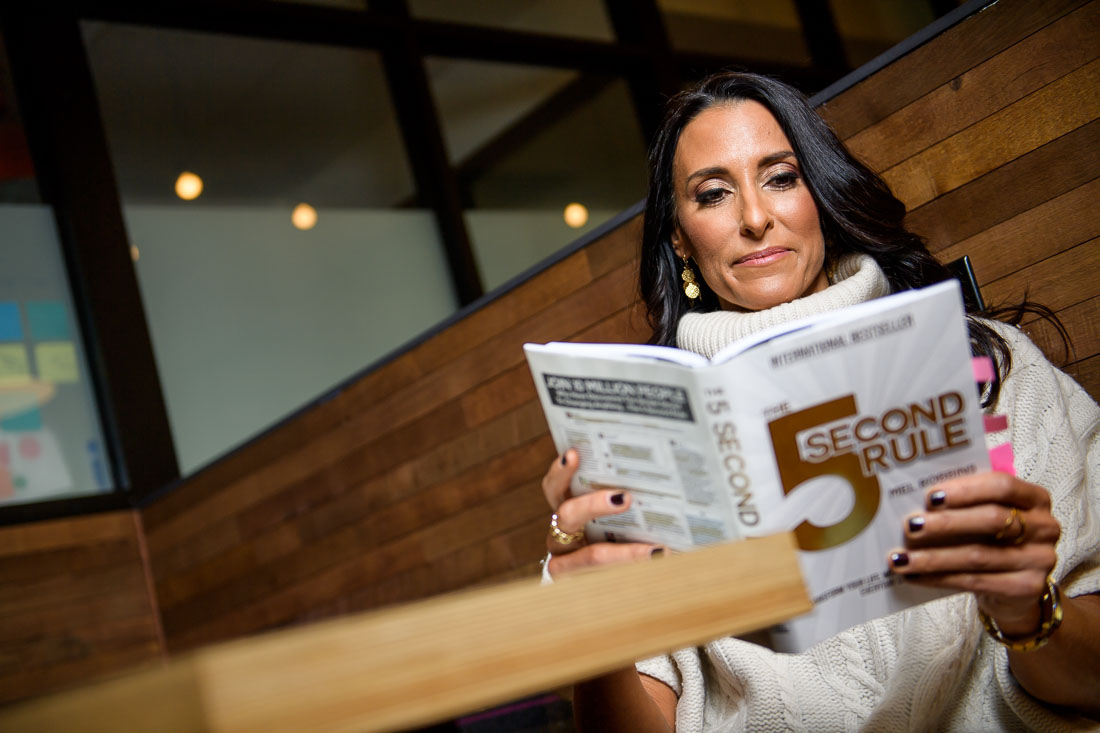 branded lifestyle portrait Kristi Data reading book at table