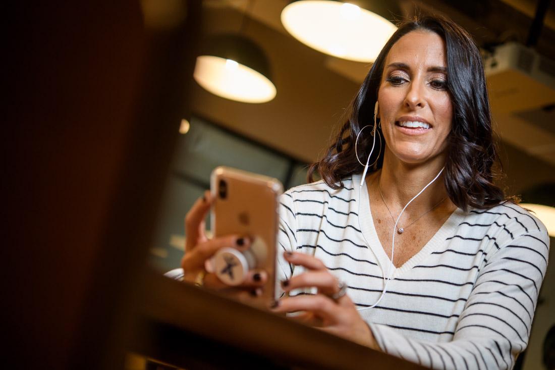branded lifestyle portrait Kristi Data listening to audible book