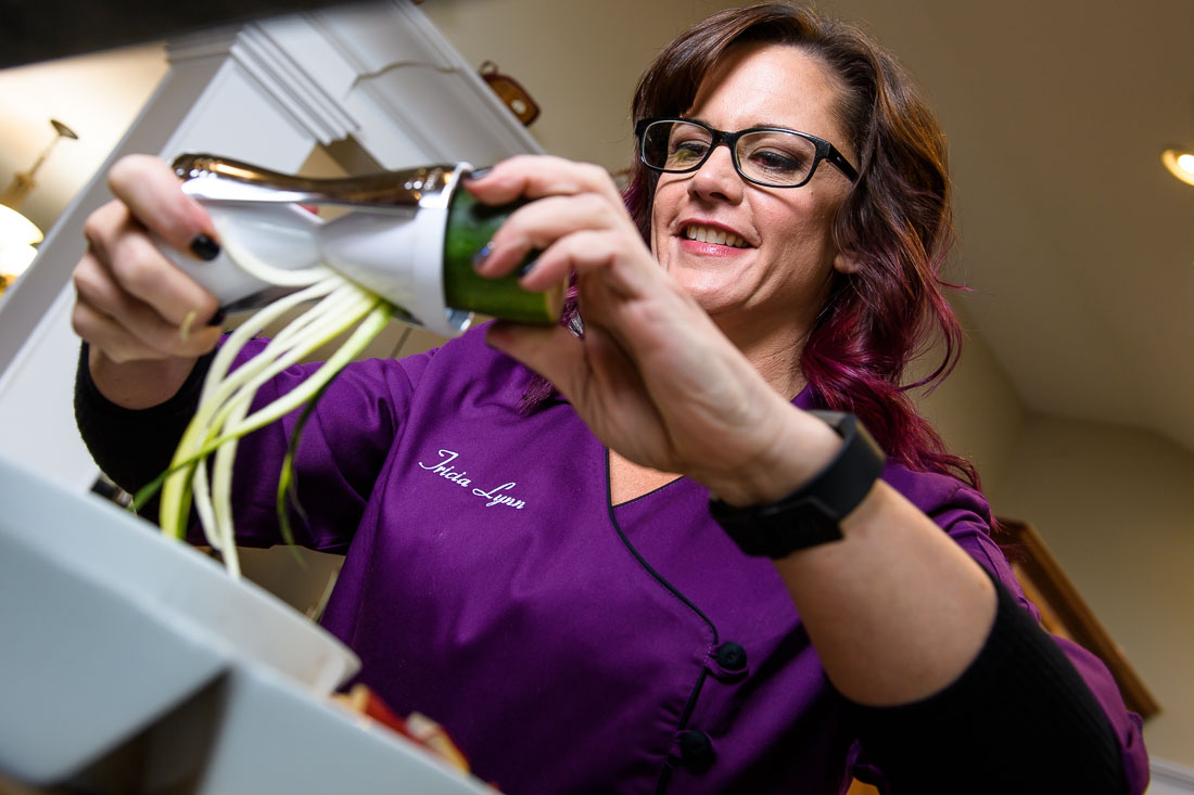 NYC Branded Lifestyle Portrait - coach tricia kallmeyer prepping a meal