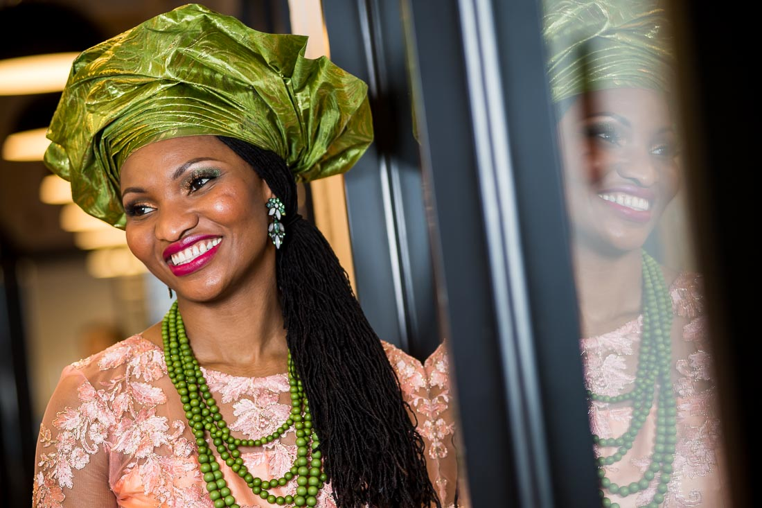NYC Branded Lifestyle Portrait Lawyer Speaker Author Chinwe Esimai smiling in Nigerian outfit