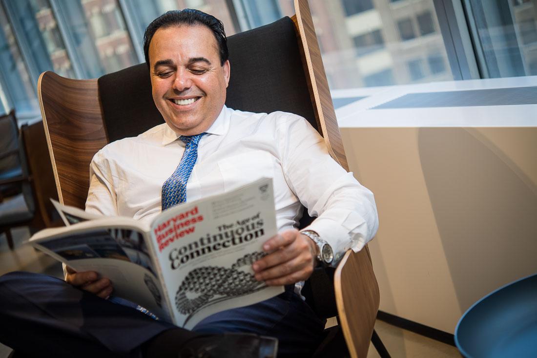 NYC Branded Lifestyle Portrait speaker author Anthony Chaine reading magazine