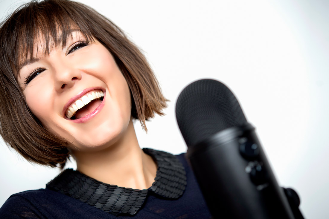 NYC Branded Lifestyle Portrait speaker author branding expert Pia Silva smiling while podcasting