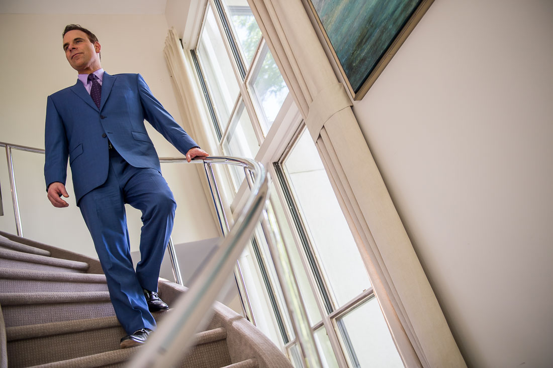 NYC Branded Lifestyle Portrait Dr. Brian Lima walking down staircase confidently