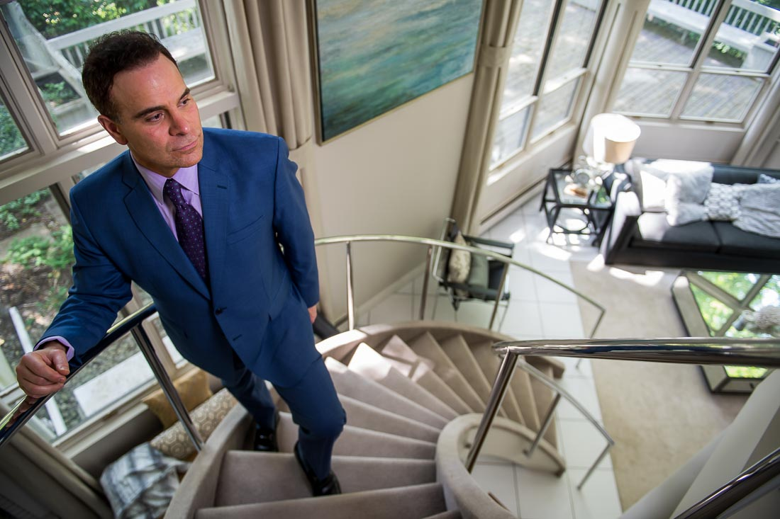 NYC Branded Lifestyle Portrait Dr. Brian Lima walking up staircase