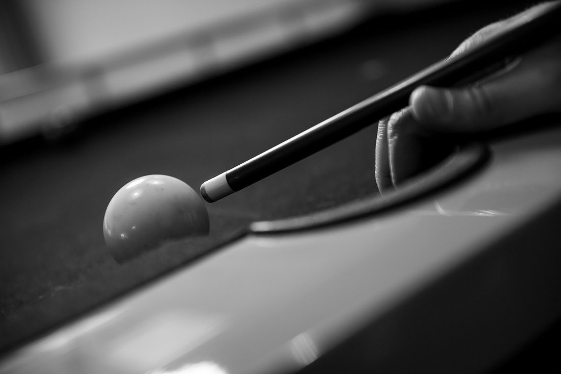 NYC Branded Lifestyle Portrait Dr. Brian Lima closeup while lining up shot on pool table