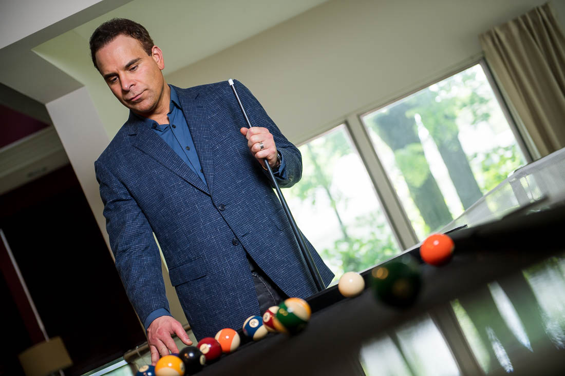 NYC Branded Lifestyle Portrait Dr. Brian Lima looking over pool table