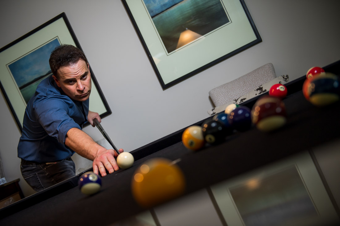 NYC Branded Lifestyle Portrait Dr. Brian Lima working the angles on pool table