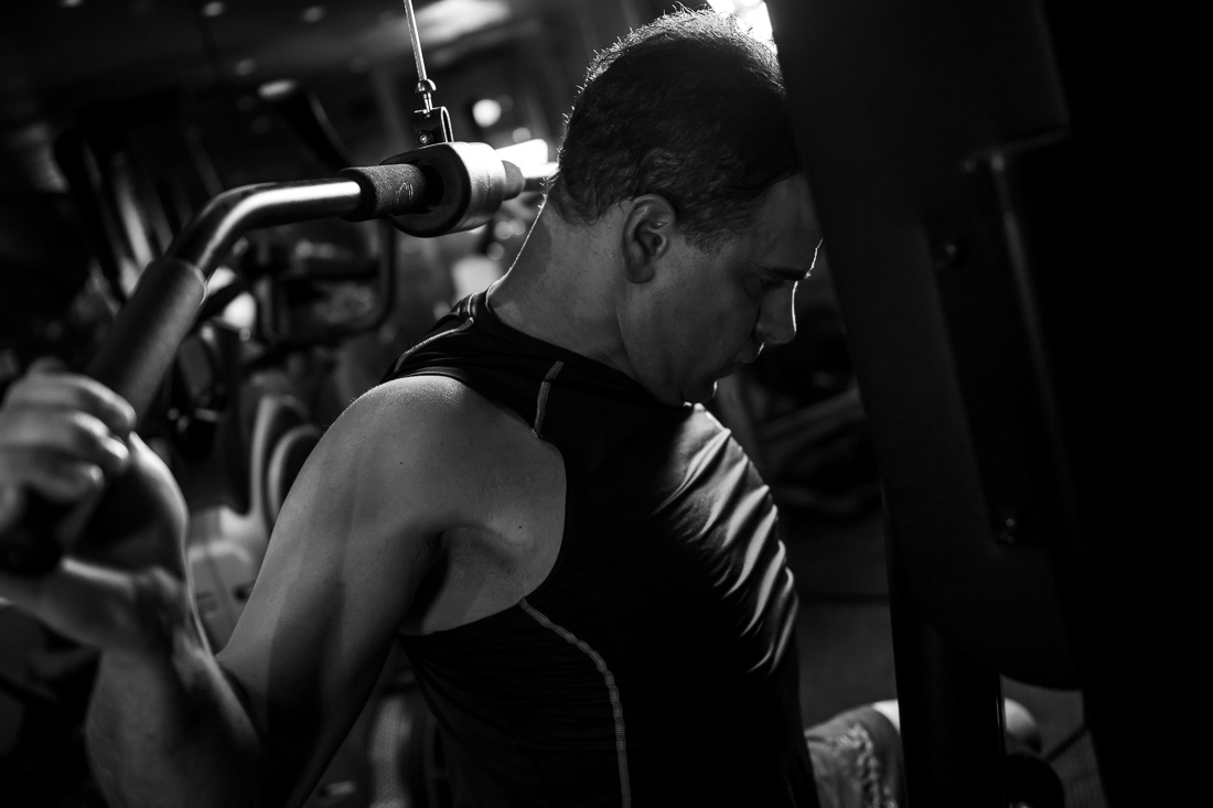 NYC Branded Lifestyle Portrait Dr. Brian Lima on pulldown lat machine