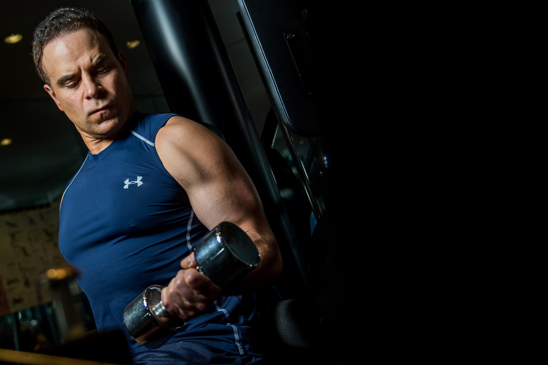NYC Branded Lifestyle Portrait Dr. Brian Lima doing bicep curls