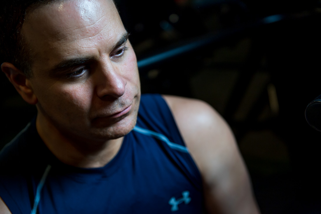 NYC Branded Lifestyle Portrait Dr. Brian Lima in gym thinking to himself
