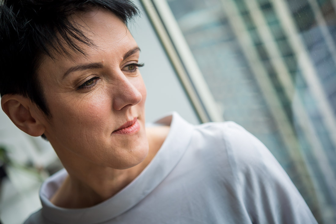 NYC Branded lifestyle portrait keynote speaker Sylvie DiGuisto thinking to herself