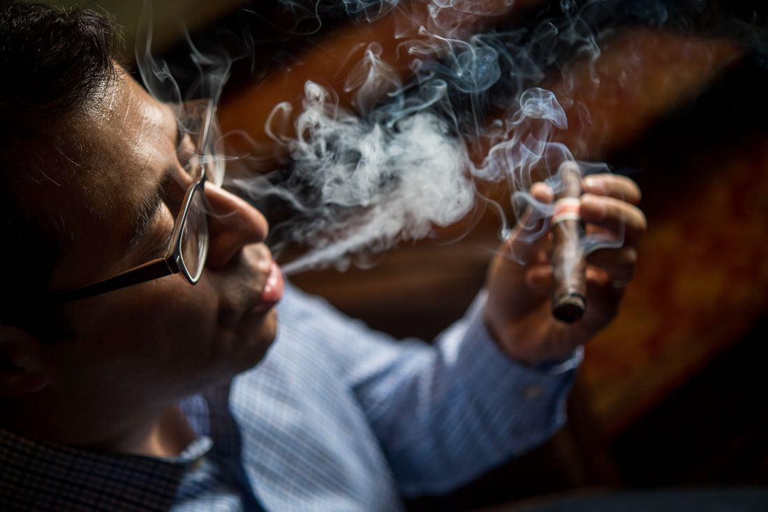 NYC Branded Lifestyle Portraits Vice Merchant Luis Paredes smoking a cigar