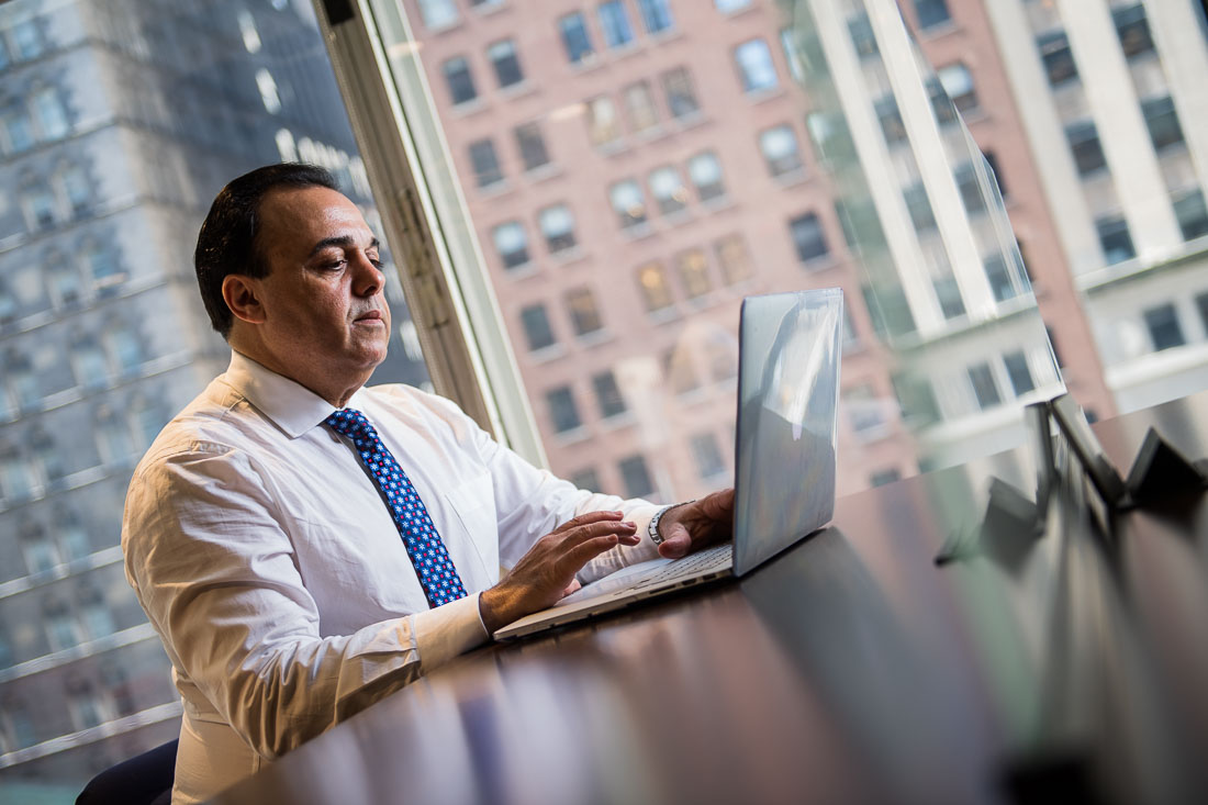 NYC Branded Lifestyle Portraits slaes and marketing executive Anthony Chaine working on laptop