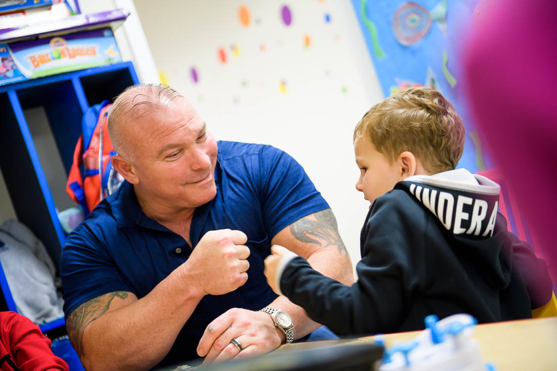 NYC Branded Lifestyle Portraits Angelwatch founder Dave Vitalli working with kids