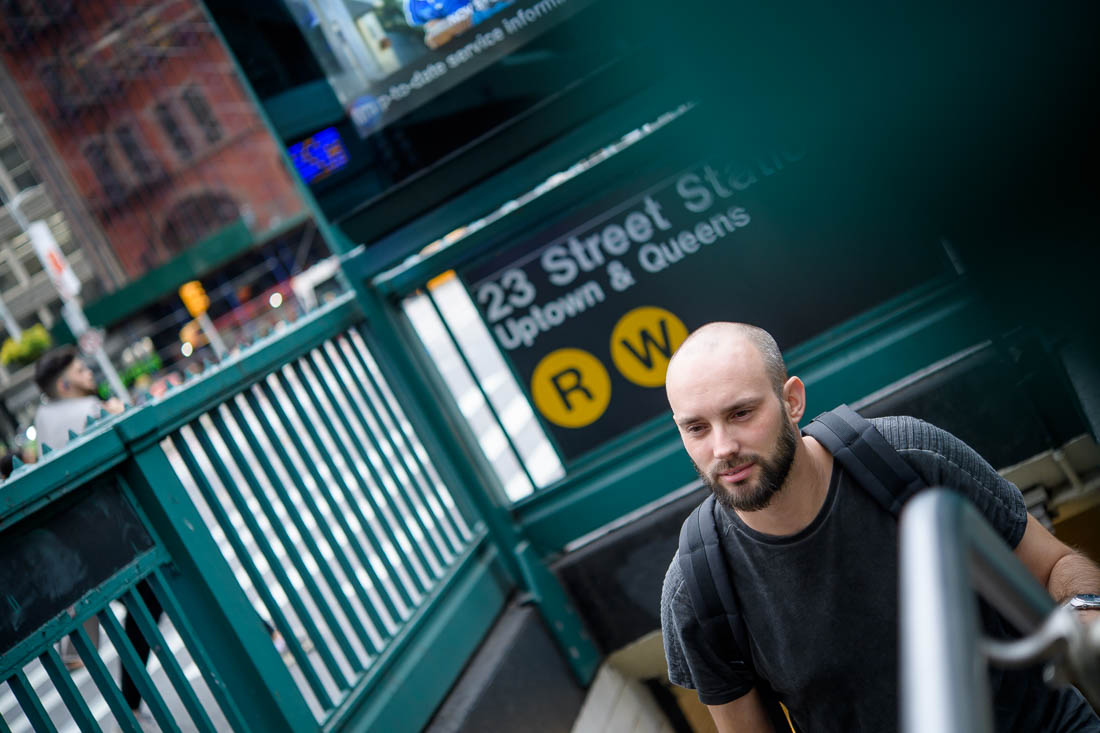 NYC Branded Lifestyle Portraits headshot photographer Maurice Jager exiting train station