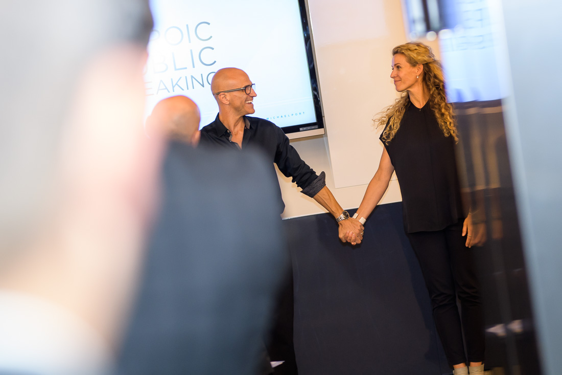 NYC Branded Lifestyle Portraits speaker coaches Michael and Amy Port taking a bow