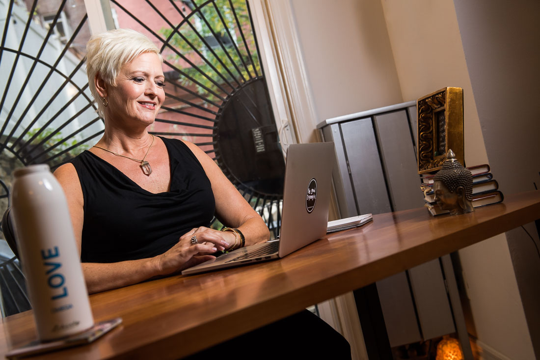 NYC Branded Lifestyle Portraits coach Carolyn Herfurth working on computer