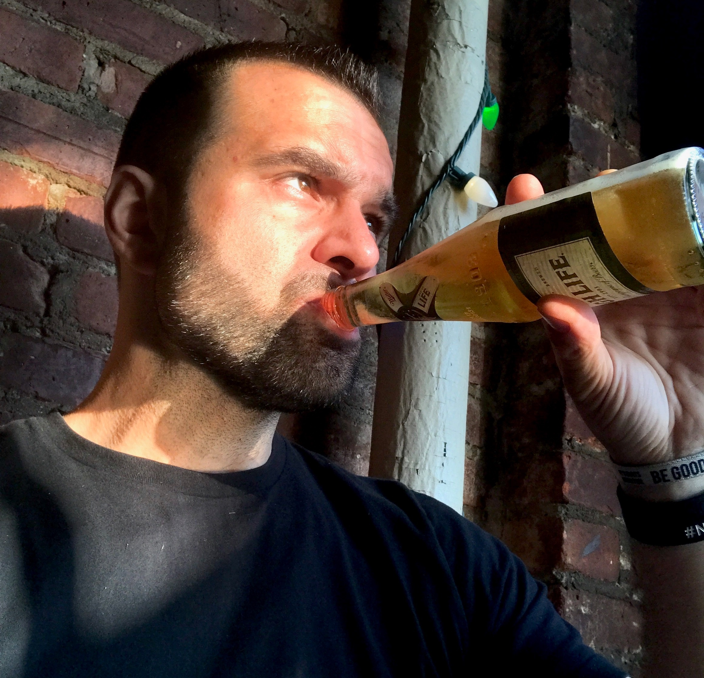 NYC Branded lifestyle portrait John DeMato drinking a beer