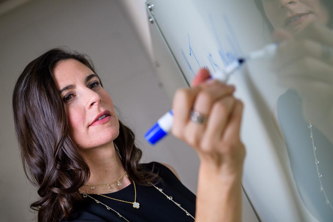 NYC Branded Lifestyle Portraits Dr Samantha Hiotakis writing on whiteboard