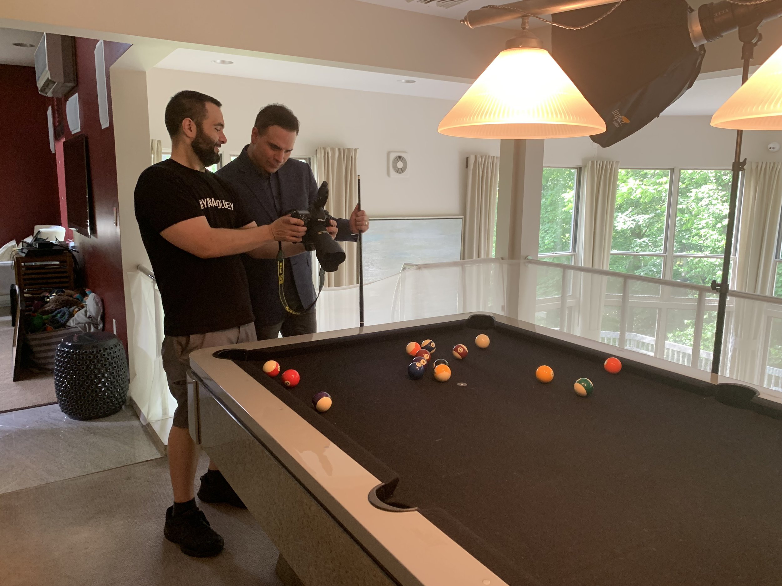 NYC Branded Lifesyle Portrait Dr Brian Lima John DeMato reviewing photo by pool table