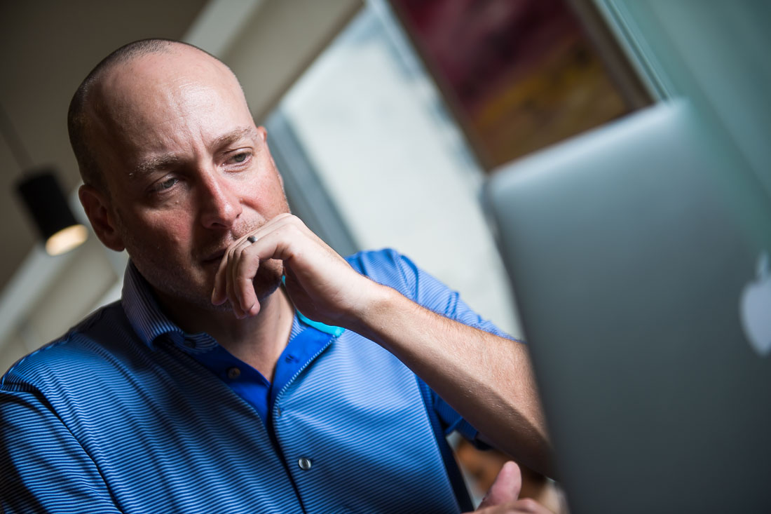 NYC branded Lifestyle Portraits Speaker Lou Diamond working on laptop