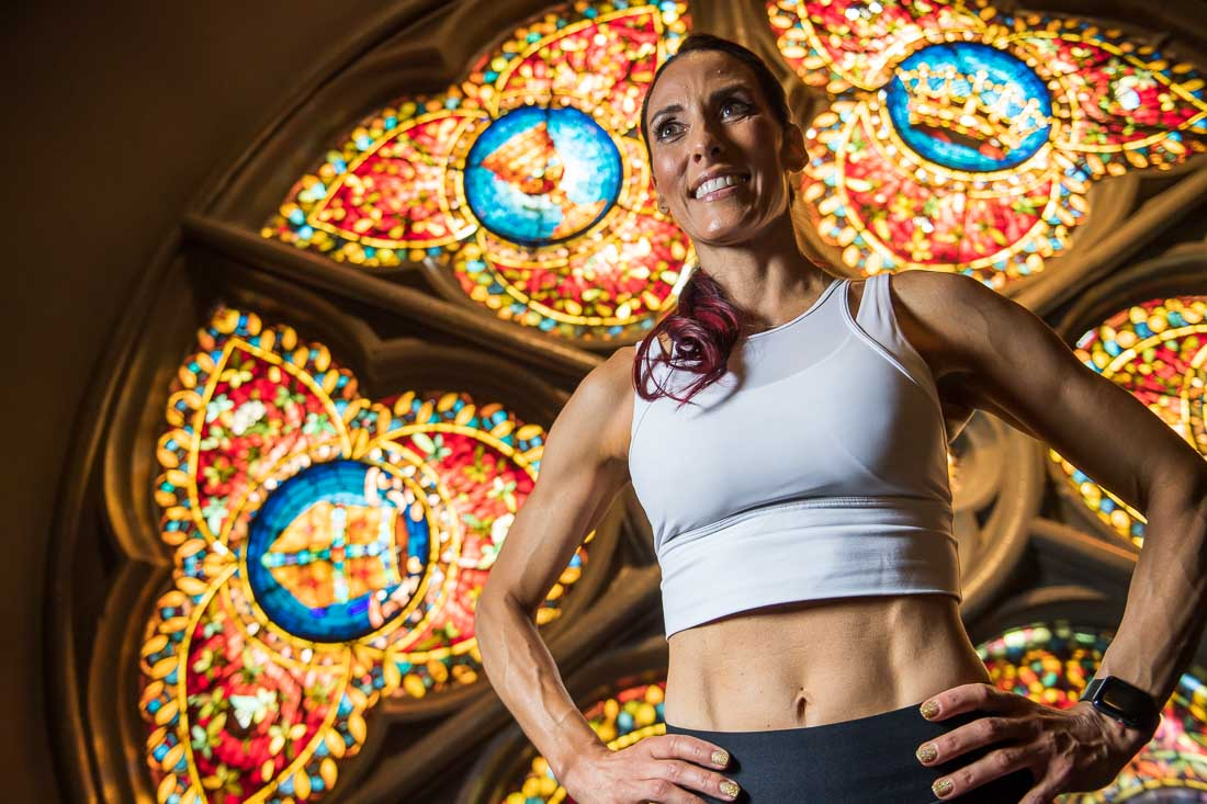 NYC Branded Lifestyle Portrait fitness nutrition expert Kristi Data smiling in workout gear
