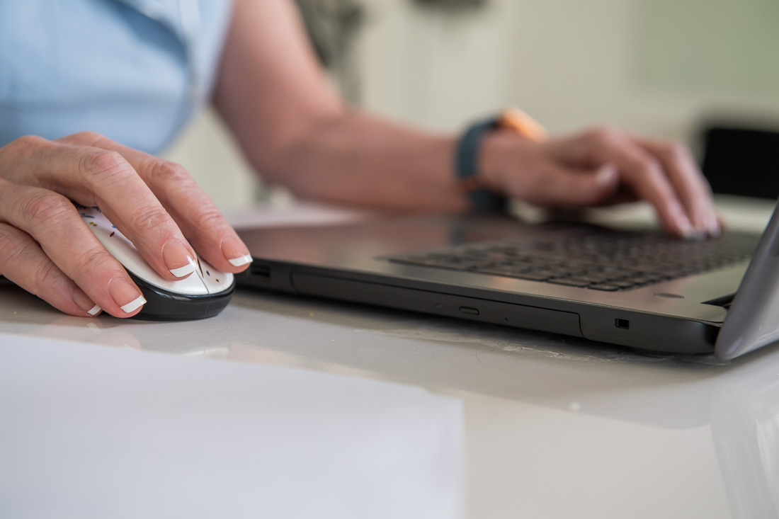 NYC branded lifestyle portraits hand on keyboard and mouse working on laptop