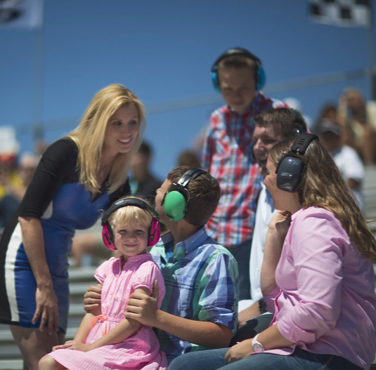 Little girl hearing protection at race.png