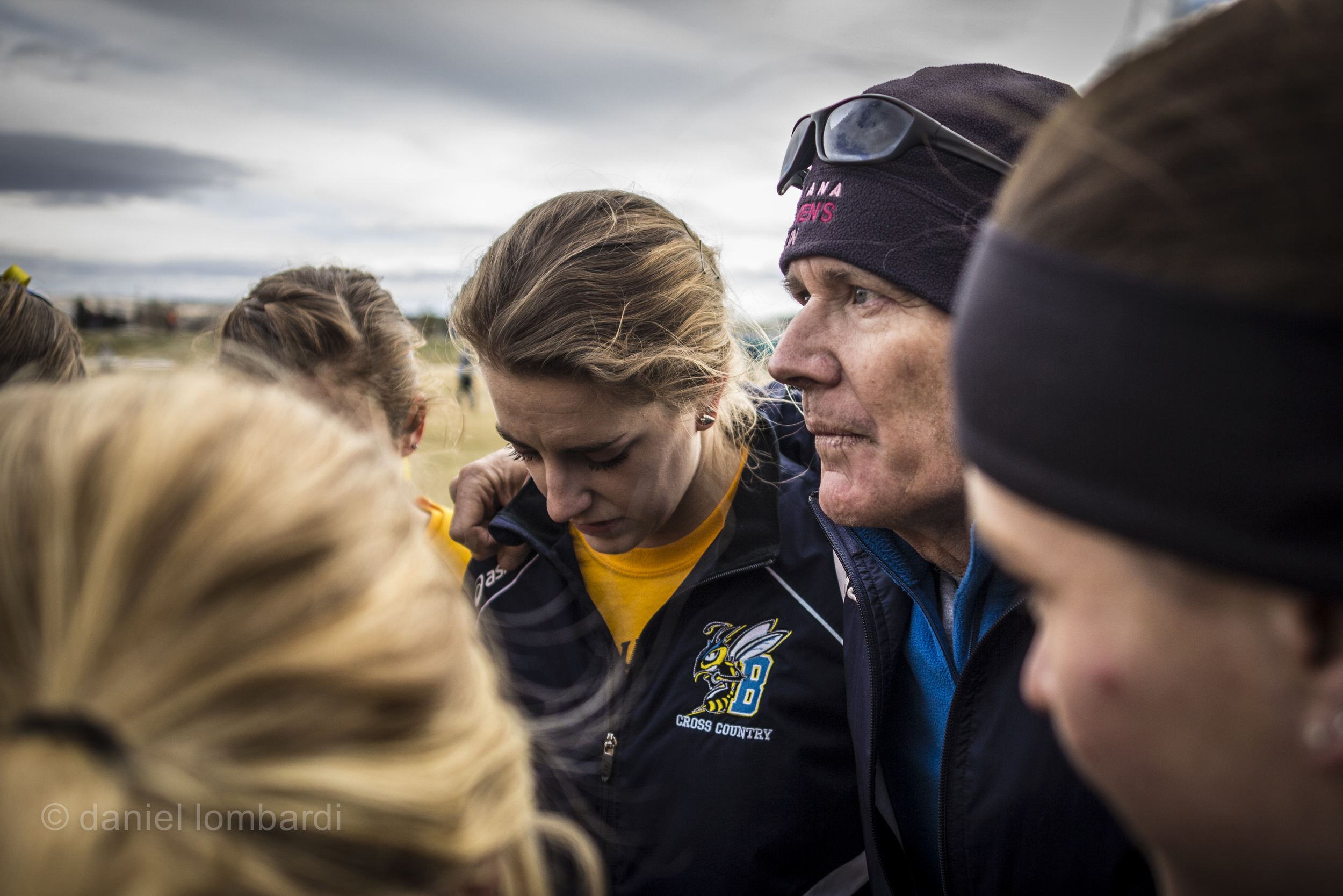 Dave Coppock shares motivational words with his athletes in the huddle before the race.